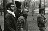 Coach Shimek and others watching cross-country runners, 1972