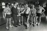 Hank Raymonds accepts cross-country trophies from Coach Allen, 1980