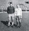 "Ray ""Buzz"" Buivid and Coach Murray pose for a publicity photograph on the football..."