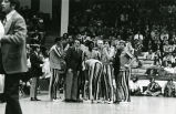 Al McGuire and team in huddle, 1972