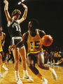 "Alfred ""Butch"" Lee moves the basketball past an opponent, 1976? - 1978?"