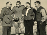 "Coach Frank J. Murray and assisants Joseph ""Red"" Dunn and John ""Tarz"" Taylor..."