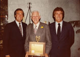 "John ""Big Train"" Sisk Sr. with sons at anniversary dinner and celebration, 1981"
