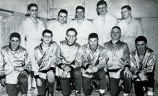Team captain Harlow Hellstrom in wrestling team photograph, 1953