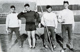 Track and field photograph including Milt Trost, Gene Ronzani, and Ernie Kukla, 1933