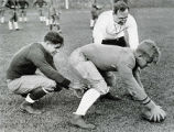 Art Krueger prepares to snap football to Gene Ronzani, 1932