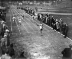 Ralph Metcalfe crossing finish line at MU-Wisconsin dual, 1934?