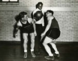 Ralph Metcalfe assists at Marquette basketball practice, 1932? - 1933?
