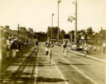 Ralph Metcalfe wins 200-meter sprint at Marquette stadium, 1934