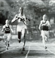Sprinter Ralph Metcalfe crosses tape ahead of runners from Michigan State and Wisconsin, 1933
