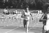 Clare Look-Jaeger finishes hurdles event, 1988