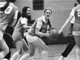 Catherine (Wright) Gadomsk looks to pass basketball, 1977