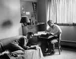 Two students study in their Schroeder Hall dorm room, 1958