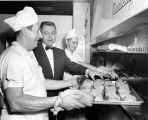 Jacob Replogle, director of food services, poses with workers in the Schroeder Hall kitchen, 1958