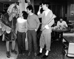 Students talk to a a turkey at a Schroeder Hall Thanksgiving banquet, 1986