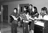 Students sing and play music for a midnight Mass in Schroeder Hall, 1970-1971