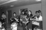 Students sing and play instruments for Midnight Mass in Schroeder Hall, 1971