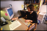 A student works at her desk in Schroeder Hall, 2000