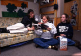 Three girls look at a magazine in their Schroeder Hall dorm room, 1998