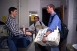 Residents chat in the laundry room in Schroeder Hall, 1998