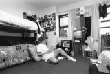 A student studies while sitting on the floor of her Cobeen Hall dorm room