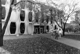 Students walk on the sidewalk on the north side of Lalumiere Language Hall, circa 1990