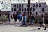 Students walk across the sidewalks on the Marquette campus, 1992