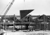 A crane lifts a portion of the roof onto the Haggerty Museum, 1983-1984