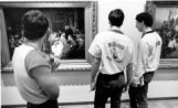 Students view artworks in the Haggerty Museum