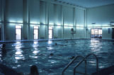 Swimmers in the pool at the Helfaer Recreation Center