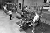 Students lift weights at the Helfaer Recreation Center