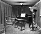 A piano, chairs and broadcasting equipment occupy the interior of the WHAD radio studio on the...