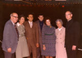Guests and Father John P. Raynor (r.) at Helfaer Theatre