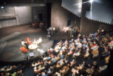 A crowd gathers for a televised event held on the stage in the Helfaer Theatre