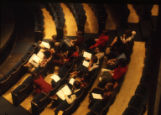 Students review their notes while seated in the auditorium in the Helfaer Theatre
