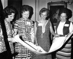 Members of the Association of Marquette University Women review blueprints for the Helfaer...
