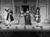 Students perform on stage in a production of The Learned Ladies, 1988