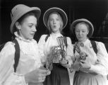 Actresses hold eggbeaters in a student production of On the Verge, 1992