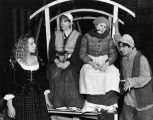 Students surround a wagon in a student production of Bertolt Brecht's Mother Courage and Her...