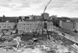 Cranes work to excavate the Cudahy Hall site, 1993