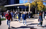 Students walk on the sidewalk outside the Wehr Chemistry Building, 1994