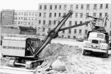 Excavators remove dirt from the Wehr Chemistry Building site, 1965