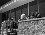 Students socialize on the stairs outside the Wehr Chemistry Building, circa 1970