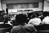 Chemistry professor Michael A. McKinney lectures to a classroom filled with students, circa 1970