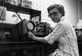 Andrea Spruck adjusts the controls on equipment in a physics laboratory, 1976