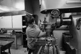 Graduate student Sue Ratkowski works at a vertical mill in the physics lab, 1973