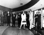 Sculptor Robert J. Hurdelbrink and his wife are congratulated by dignitaries in the lobby of the...