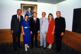 David A. Straz, Jr. poses with a group in front of his portrait in the building bearing his name,...