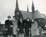 Marquette University President Edward J. O'Donnell, S.J., and a variety of dignitaries stand on...