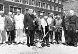 Dignitaries pose during the groundbreaking ceremony for the Dental School addition, 1956